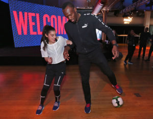 NEW YORK, NY - MAY 04:  Usain Bolt and Lisa Freestyle join PUMA as they launch the latest NETFIT technology in their performance and sportstyle shoes at the Altman Building on May 4, 2017 in New York City.  (Photo by Rob Kim/Getty Images for Puma)